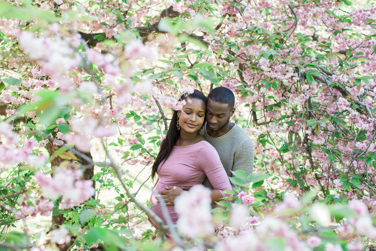Maternity session in the New York Botanical Gardens cherry blossoms. Photos by Kelly Kollar Photography